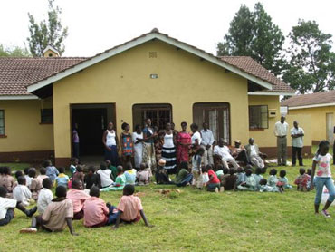 Karateng' kids and community discussing plans for their future library.
