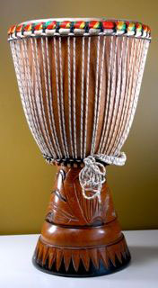 When you donate $150 or more to this project, you will receive a beautiful handmade Senegalese Djembe drum like this.
