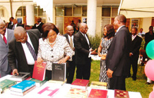 Chief Justice Examining the Books with Martin Amidu (Also pictured: Nana Fredua Owusu Agyeman, Registrar of the Law School and Nene Amegatcher, Member of the ABA's SIL Africa Committee and Lecturer at the Ghana School of Law)
