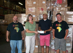 Eagle Scout Manvir Bhagrath presented a generous $600 donation to Deborah McDonald, Assistant Director of Books For Africa, alongside Warehouse Managers Jeremy Bostwick (L) and Brad Mattson (R).