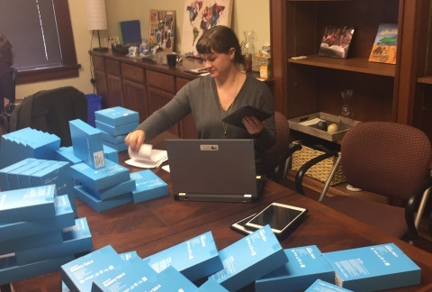 BFA Database and Development Coordinator Erin Yates works to prepare and catalog Samsung Galaxy tables for shipment to Africa.