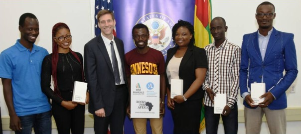 Mr. Ryan Ballow, U.S. Embassy's Political-Economic Chief, and Mr. Akebim (middle with t-shirt), surrounded by recipients: Dr. Bagassam Sama (far right), Dr. Constant Djiwa, (second from right), Dr. Sonia Tchaptchet (3rd from right), and medical student Estelle Tchasees (second from left).