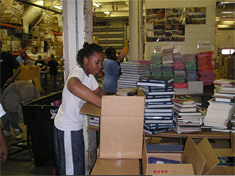 Volunteers sorting and packing books at the Books For Africa warehouse in St. Paul, Minnesota.